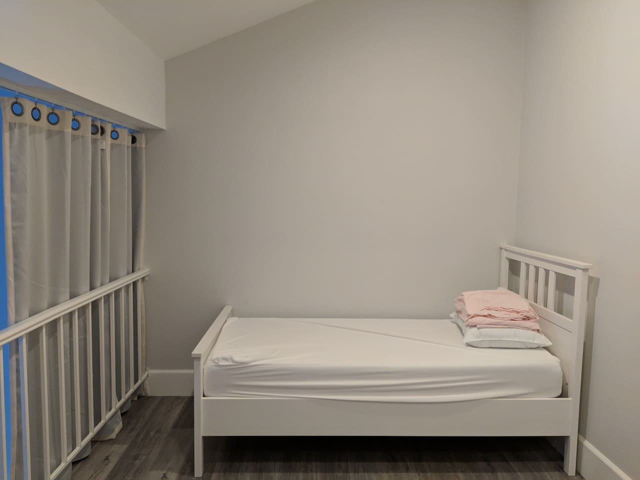 Loft with twin bed and privacy curtains that go across