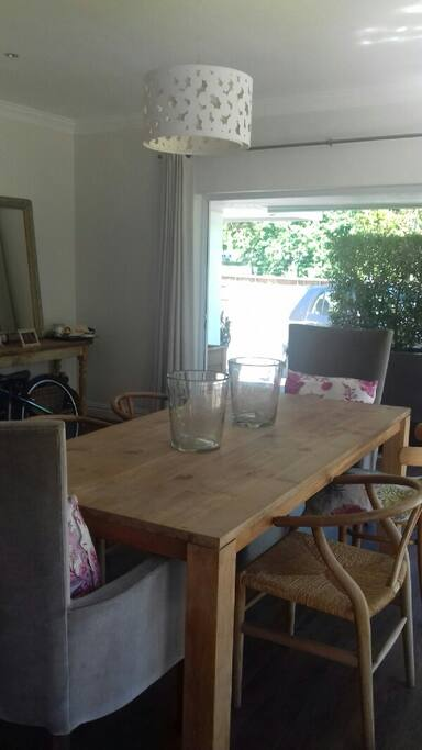 Large open plan dining/lounge. Stacking doors open to outside entertaiment area