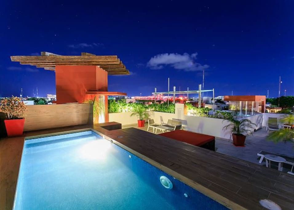 Shared rooftop pool and sitting area