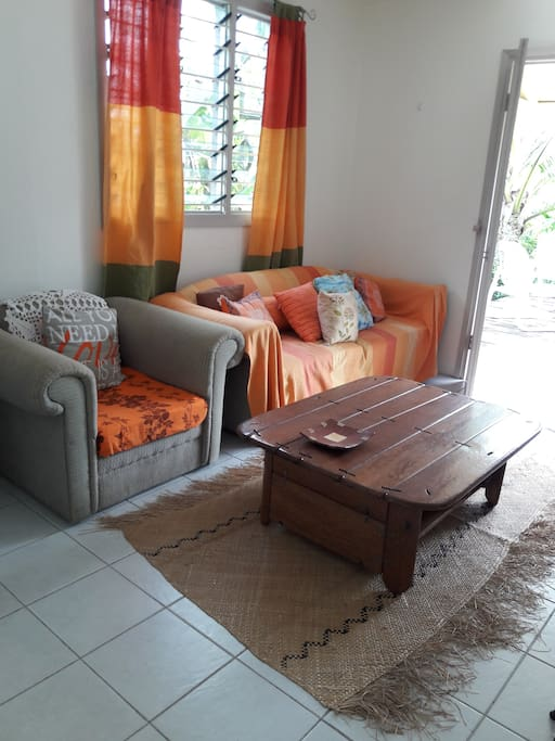 Living room opens up to deck