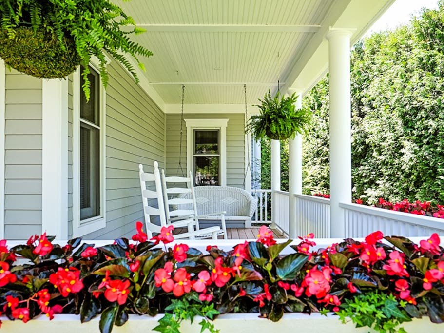 Beautiful Front Porch with Chairs and Swing