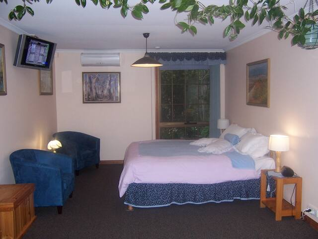 Your very comfortable bedroom with a king size bed / or two singles