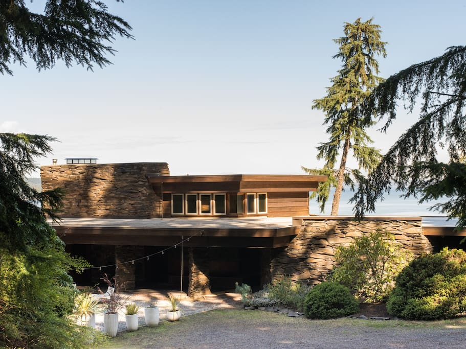 Welcome to our home. Designed by the Rosenbaum family and built in 1964, this house follows FLW's Usonian design concepts. Set on a high bank, overlooking the puget sound.