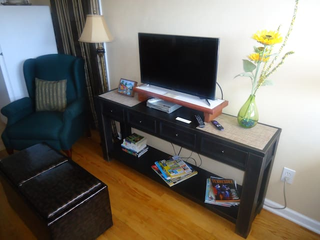 Smart TV with antenna for local stations..streaming business news & movies...DVD player.   Drawers have local maps and other local information.