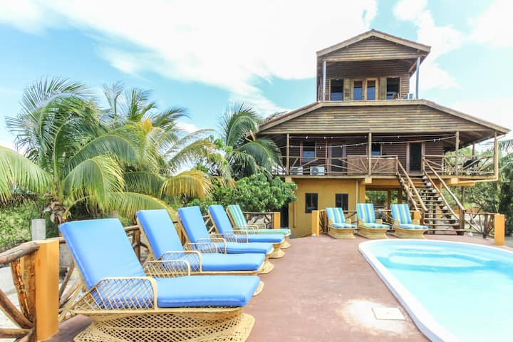 Waterfront villa w/ private pool, balcony, partial AC, strong WiFi-walk to beach