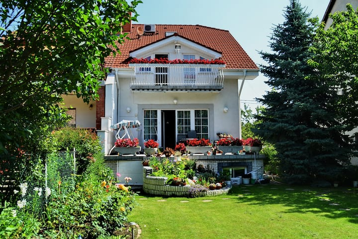 Budapest Airport, house with flower garden. Room A