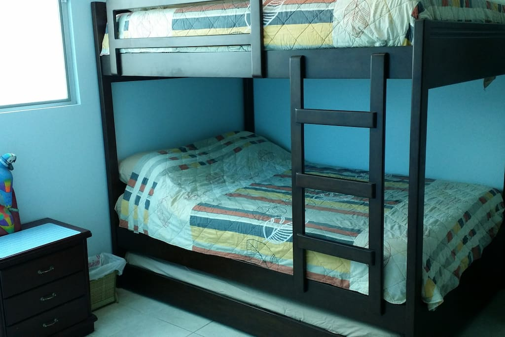 New High Quality Bunk Bed System with orthopedic mattresses.  Upper level has Full Size bed. Standard Level has Full Size bed. Trundle Level has Twin Size Bed.