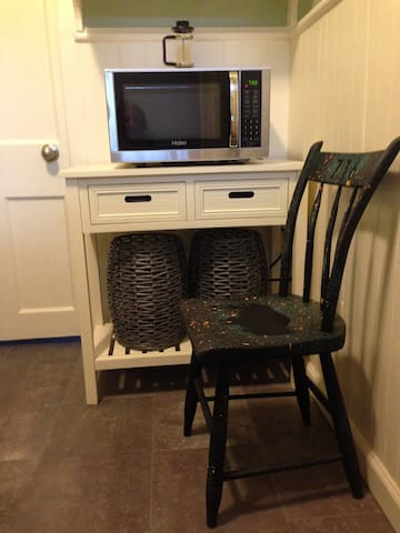 Galley kitchen with table and chairs