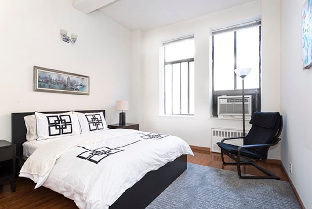 Simply immense master Bedroom with lots of light & energy thoughout the day. This bedroom has a Plush new queen sized mattress & new bedding. A seprate seating area and large closets and drawers. Huge 8foot Loft windows & beamed ceilings.