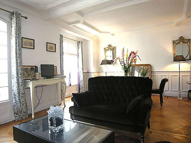 Living: The 40 square meters living room has 2 windows facing street and it is furnished with : dining table for 6 people, sofa, coffee table, TV, DVD, decorative fireplace, hard wooden floor.