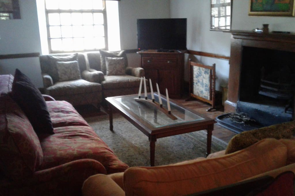 Large comfortable lounge with fireplace and TV/DSTV