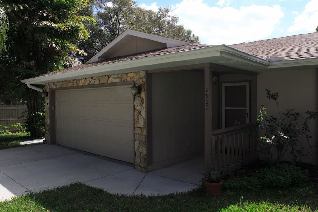 The front entry. Covered front door (very convenient when it's raining!!) Side door access, as well as electronic garage door add multiple options for entry.