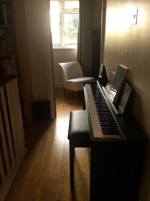 Upper floor landing with a piano