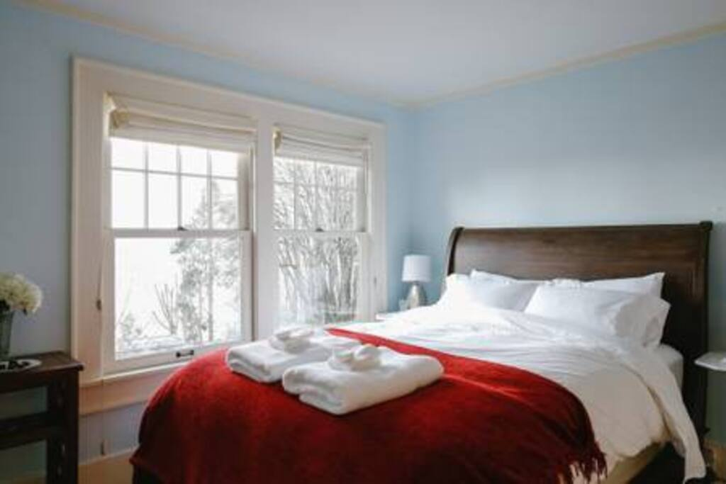 Your first bedroom, super comfortable bed, luxurious towels and linens, and plenty of natural light