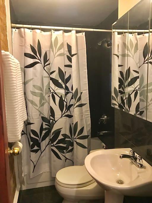 Generously sized granite-tiled bathroom