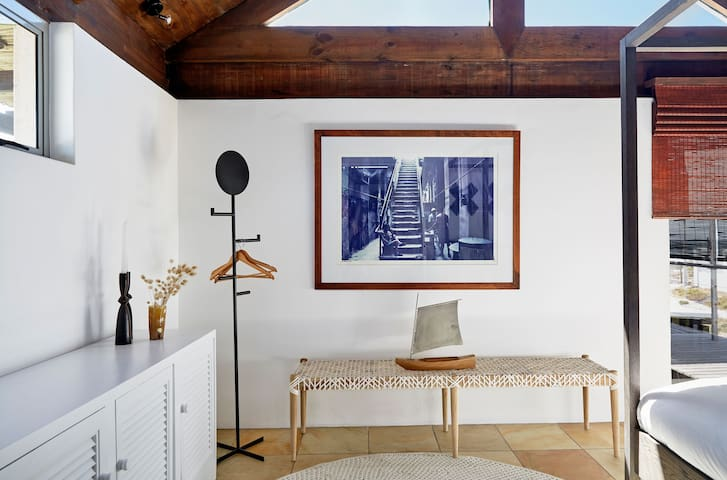 The light-filled third bedroom suite is stylishly furnished and offers view of the  the dune and the waves