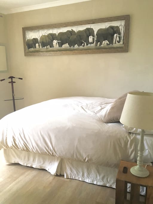 Light airy bedroom with brand new double bed and linen. Looks out to a private garden.