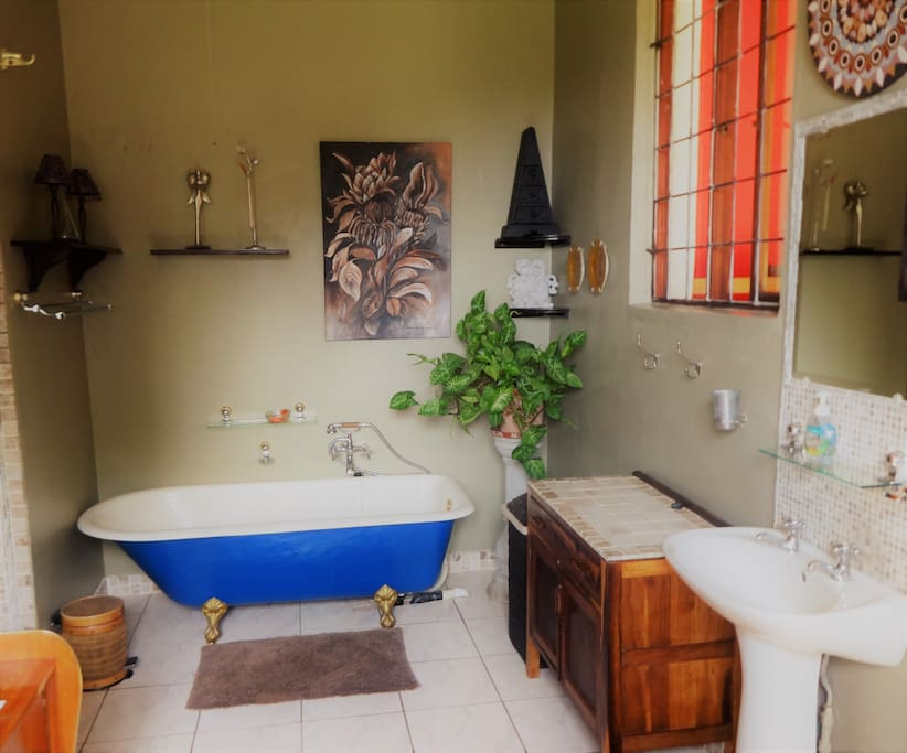 Full bathroom with toilet, shower and bath