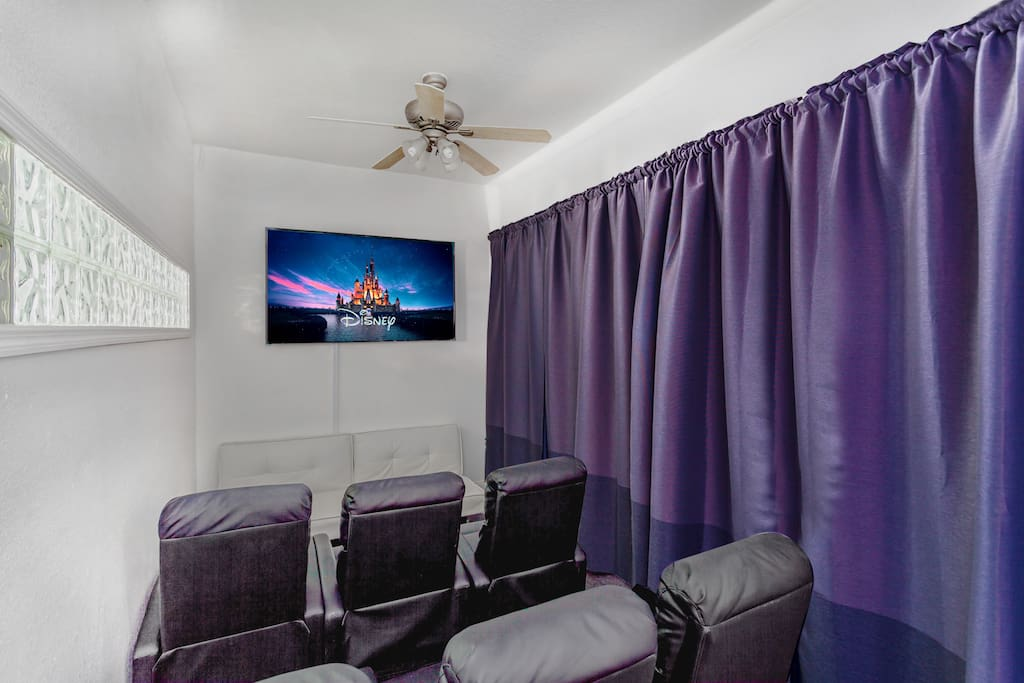 In-house movie theater room with 70-inch 4K Smart TV