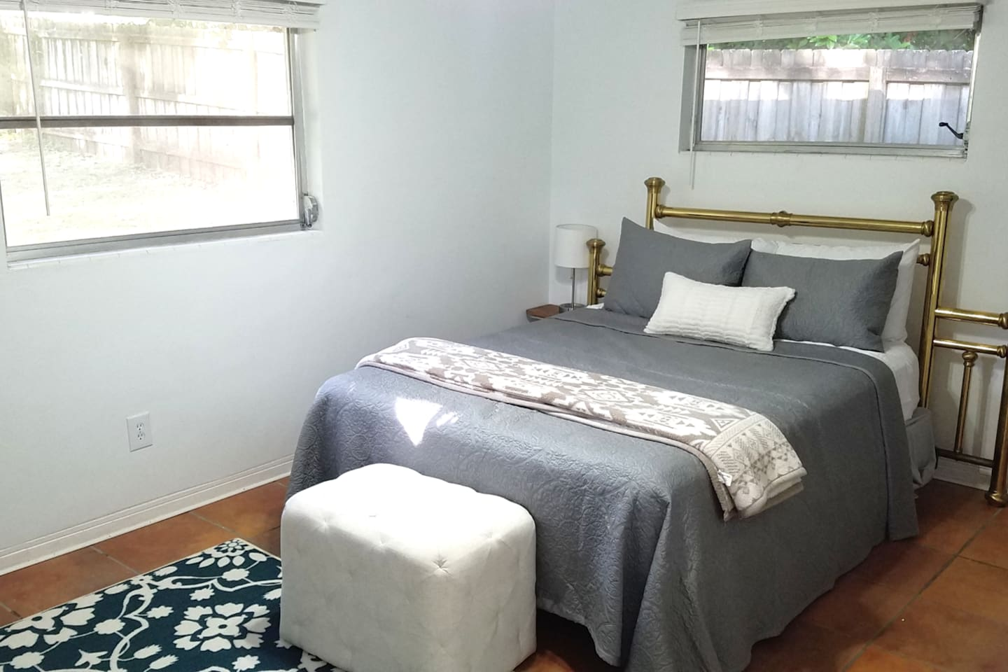 Private suite with queen bed and full bathroom available for guests.  Great natural light and ceiling fan!
