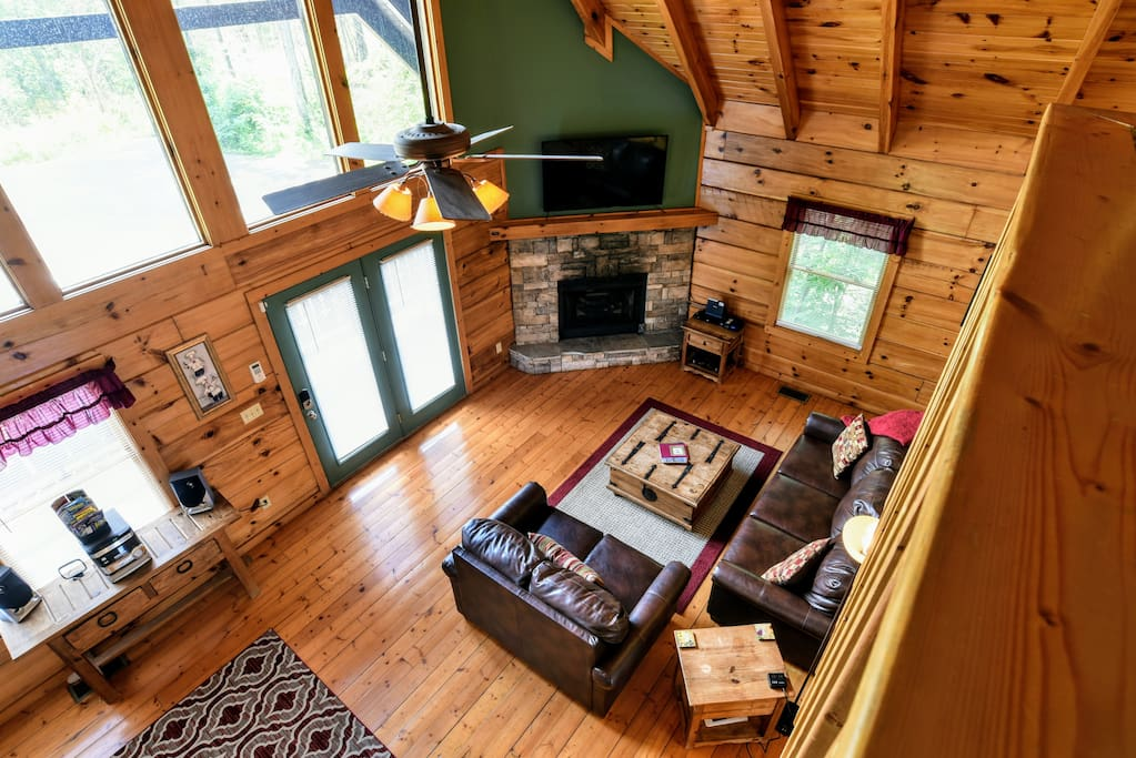 "Large, open den boasts a 55"" HDTV, cathedral ceilings and a sleeper sofa."