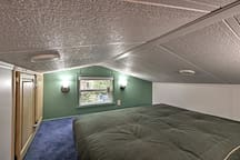 The cozy loft area is outfitted with a sleeper sofa!