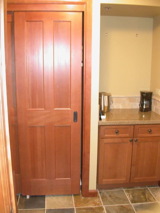 Closet and cabinet with mini fridge, microwave and coffee pot.