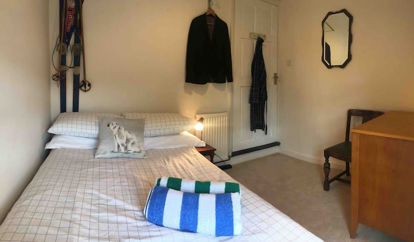The smaller of the two bedrooms with compact double bed (4' 1200mm). Bright, sunny and quiet room with blackout blind.