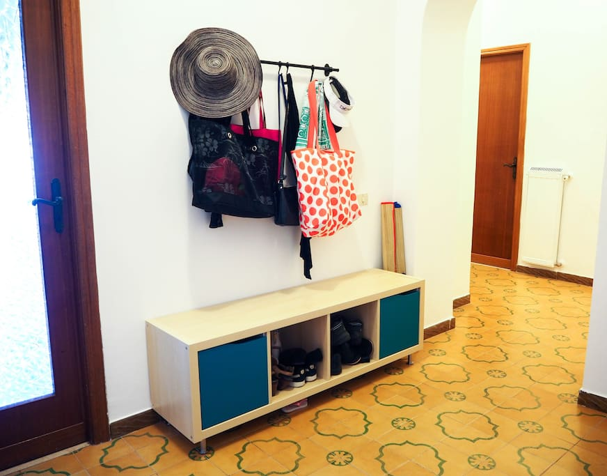 Entryway with storage for your shoes, bags, hats and more..