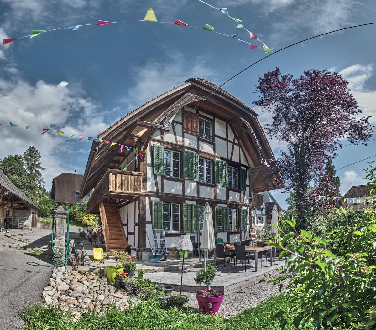 farm stays switzerland | whimsical farmhouse with a hot tub, meikirch