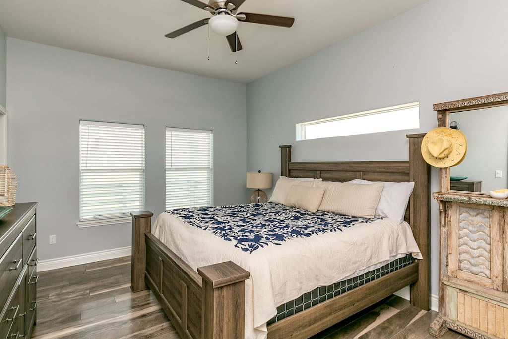 The master bedroom has a king-size bed