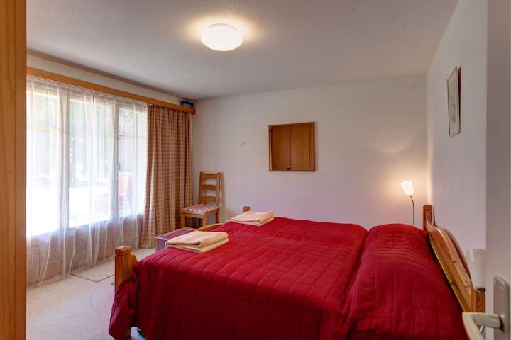 Double bedroom with doors onto terrace.