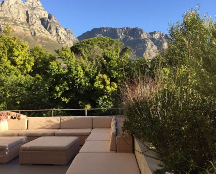 Serene and sheltered terrace with views of the back of Table Mountain and the cable car