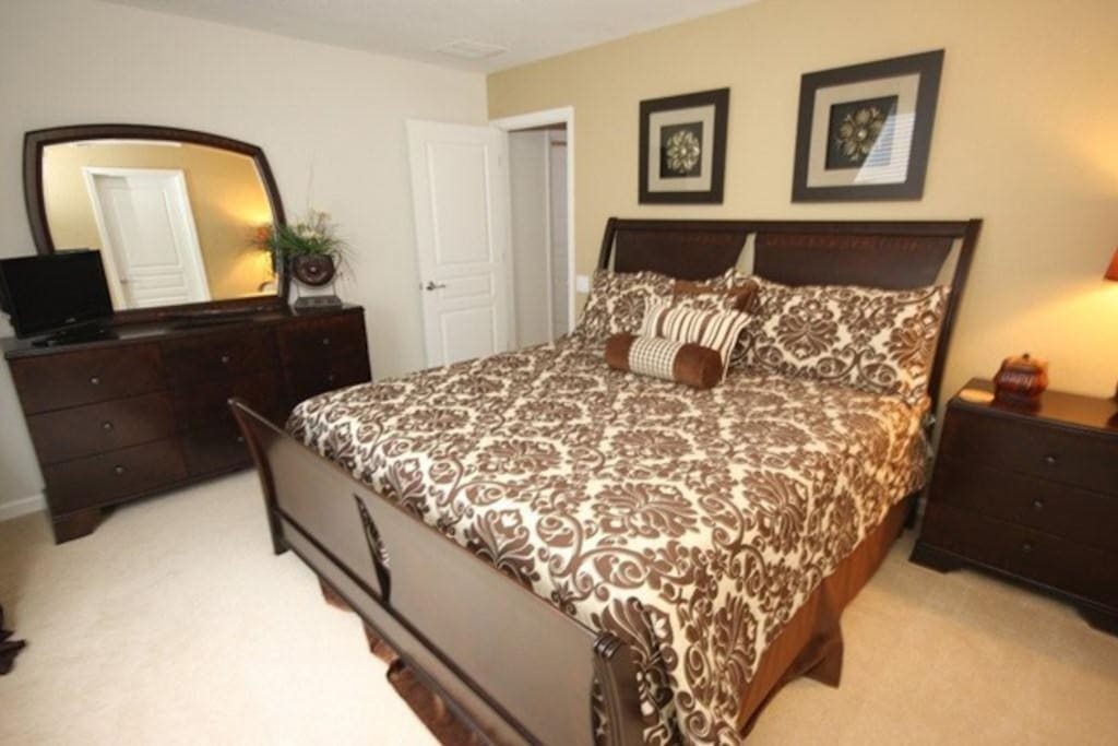 Take in your luxurious surroundings in the king master bedroom