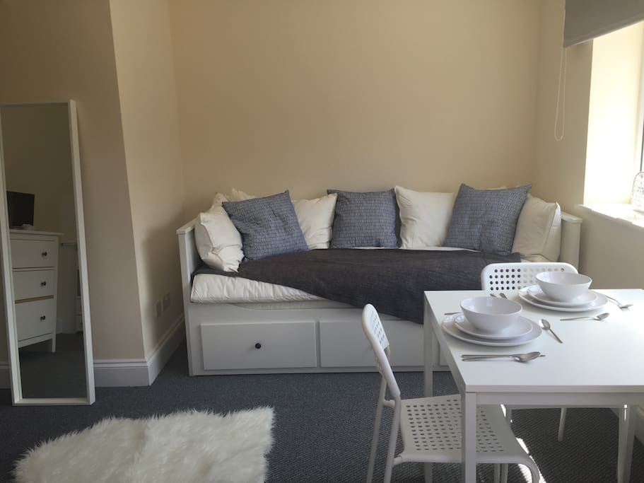Cosy studio room with comfy single or double bed that doubles up a sofa during the day.