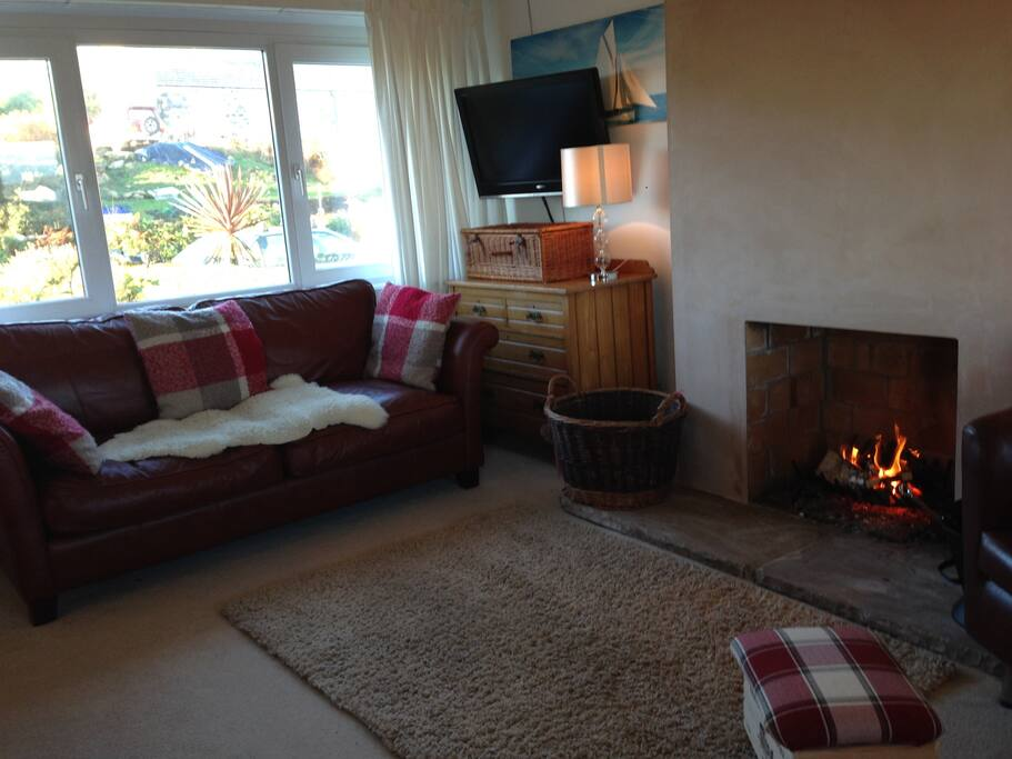 Comfortable sitting room with big open fire