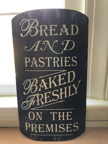 Freshly baked breakfast bread and a Keurig coffee pot. Coffee and tea pods available.