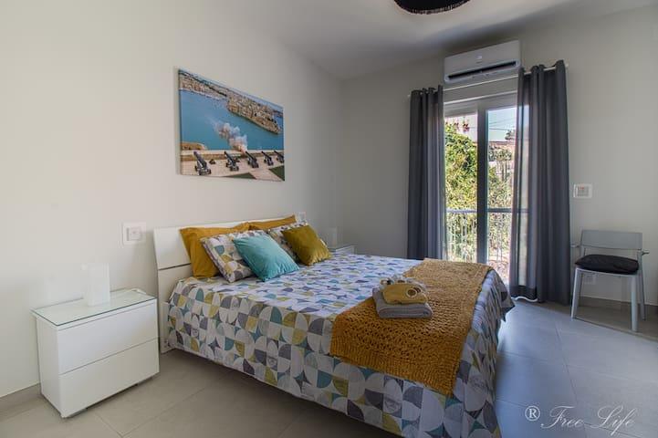 Main bedroom with balcony of  Mgarr fields/Ghajnsielem views