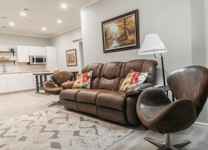 Cozy up to watch a movie or read a good book on the overstuffed leather sofa. Open concept kitchen/living area keeps the space open and inviting.