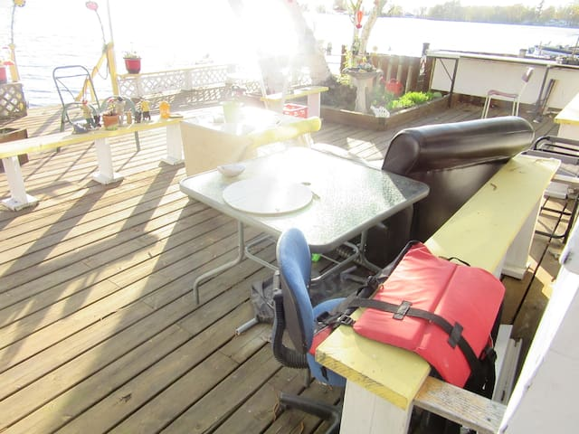 The deck has a Gas BBQ, propane Campfire, outside shower, large L-shape table, water fountain, 2 4-person swings, lounges, bird houses, bird feeders, miniature music figurines, 3 Kayaks, Bikes, paddles, life jackets , Ontario  biggest pool (Lake).