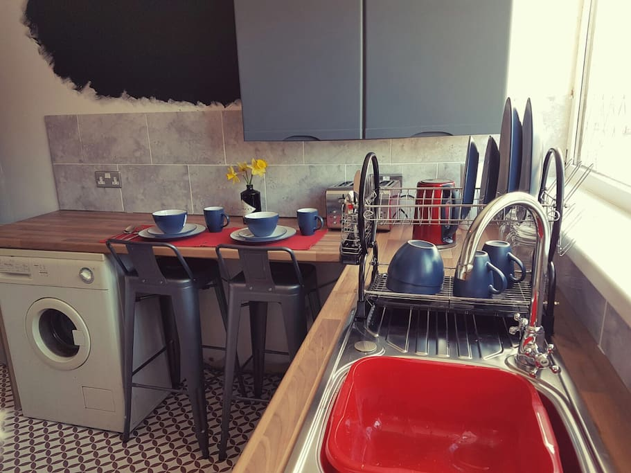 Fully equipped kitchen including breakfast bar, washer/dryer and 4 sets of everything you will need to cook up a feast