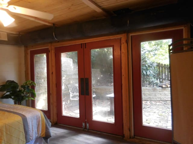 Entry Doors and Windows to Courtyard.  Blinds Provided for Privacy.