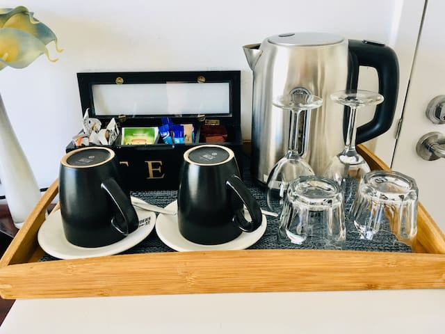 Your room comes with a kettle, small fridge and cups and glasses and a starter pack of coffee, tea, milk & sugar.