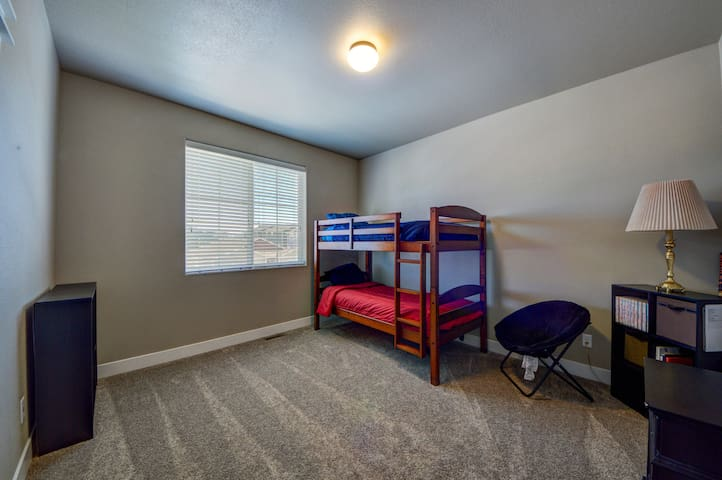 The second guest bedroom has twin bunk beds and is perfect for kids!