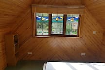 Lovely studio with green private area across