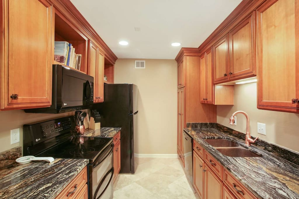 Updated kitchen with high end maple cabinets, granite countertops and hammered copper sink.