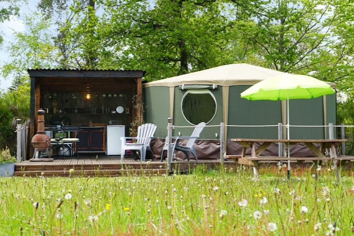 The yurt with it's covered summer kitchen. Less than 50m to the shower and toilet facilities.