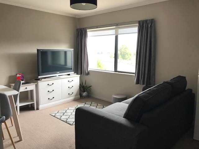 "Lounge/Dinning Area with 55"" TV (free view) and double sofa bed"