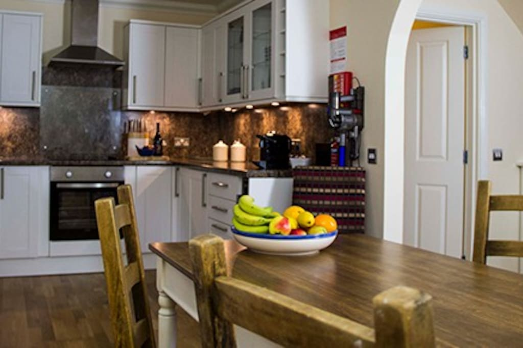 relax in the open plan kitchen/living dining area