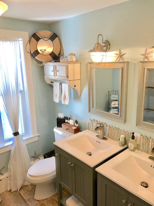 2nd floor remodeled full bathroom with selections of shampoo, conditioner, body wash, and new toothbrushes if needed.